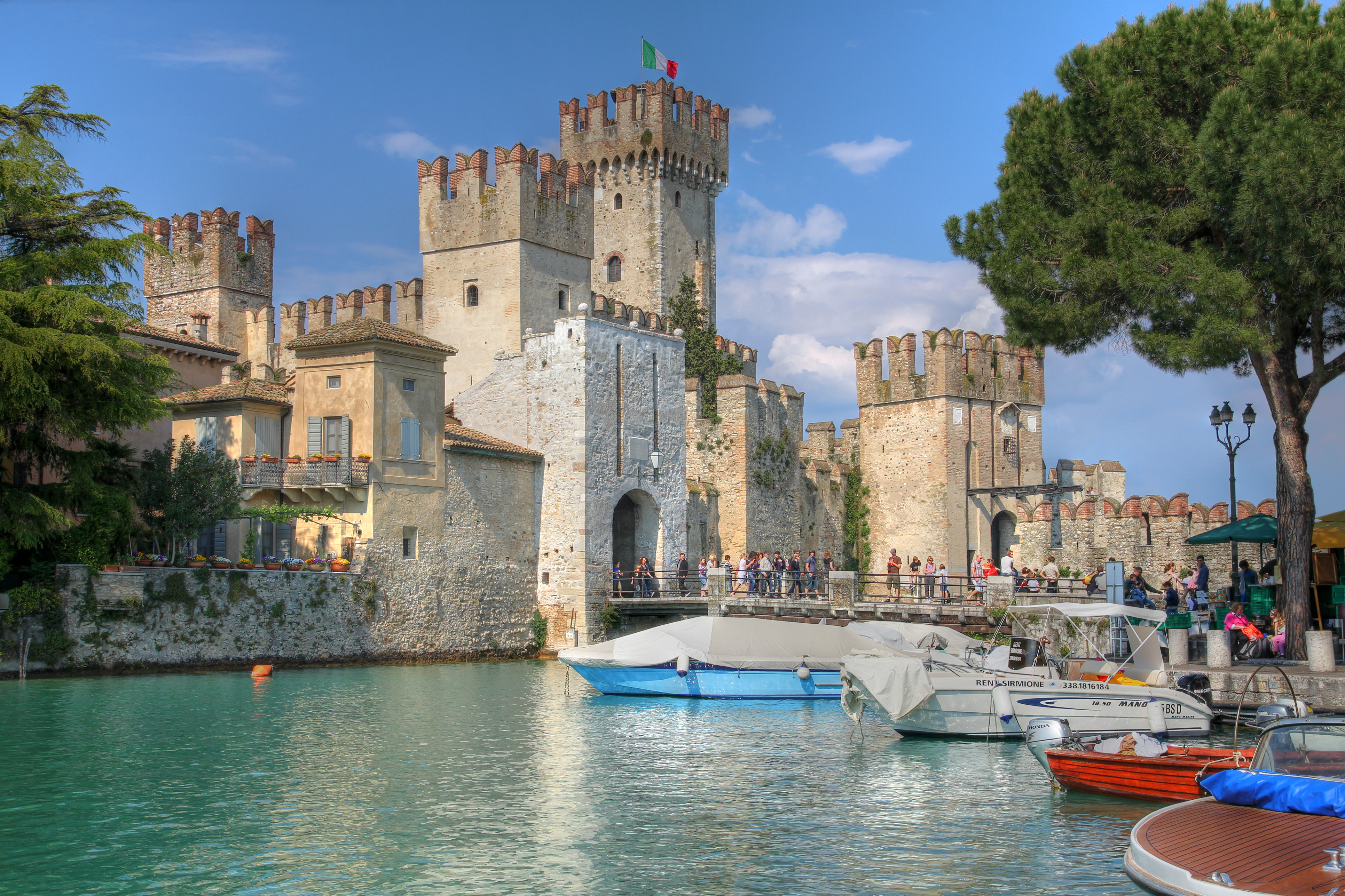 """Sirmione, Italy - April 27th, 2011 - Tourists visiting Scaliger Castle (Castello Scaligero) in Sirmione, on Lake Garda, Italy during spring break."""